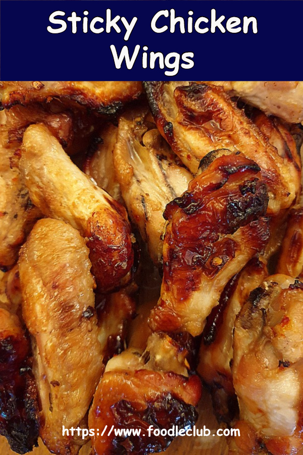 A pile of sticky chicken wings.