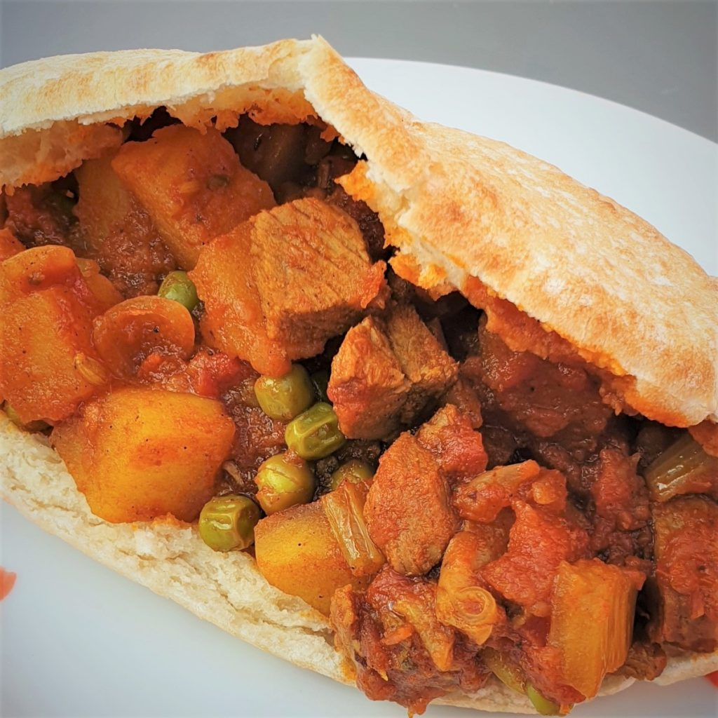 Lamb curry in a slice of pita bread