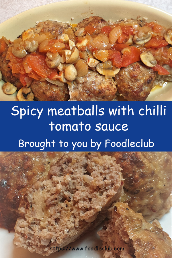 Meatballs in a dish covered with tomato sauce.