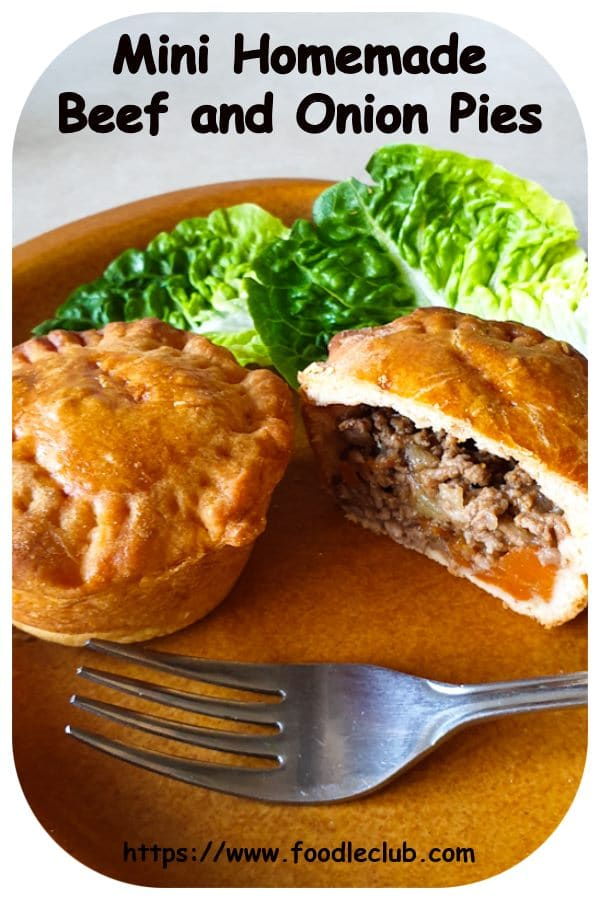 Beef and onion pies showing the inside of one pie
