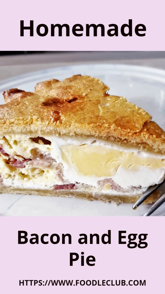 A slice of bacon and egg pie on a plate