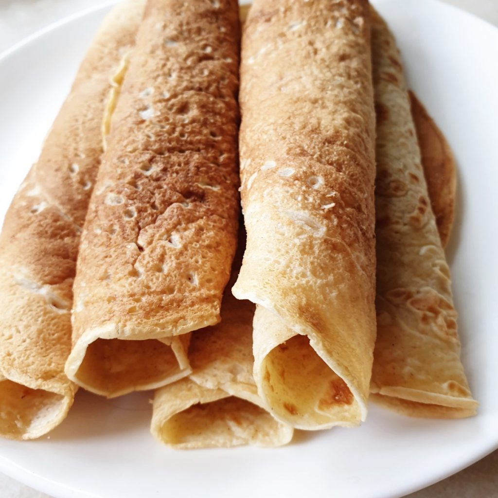 A plate of rolled crepes.