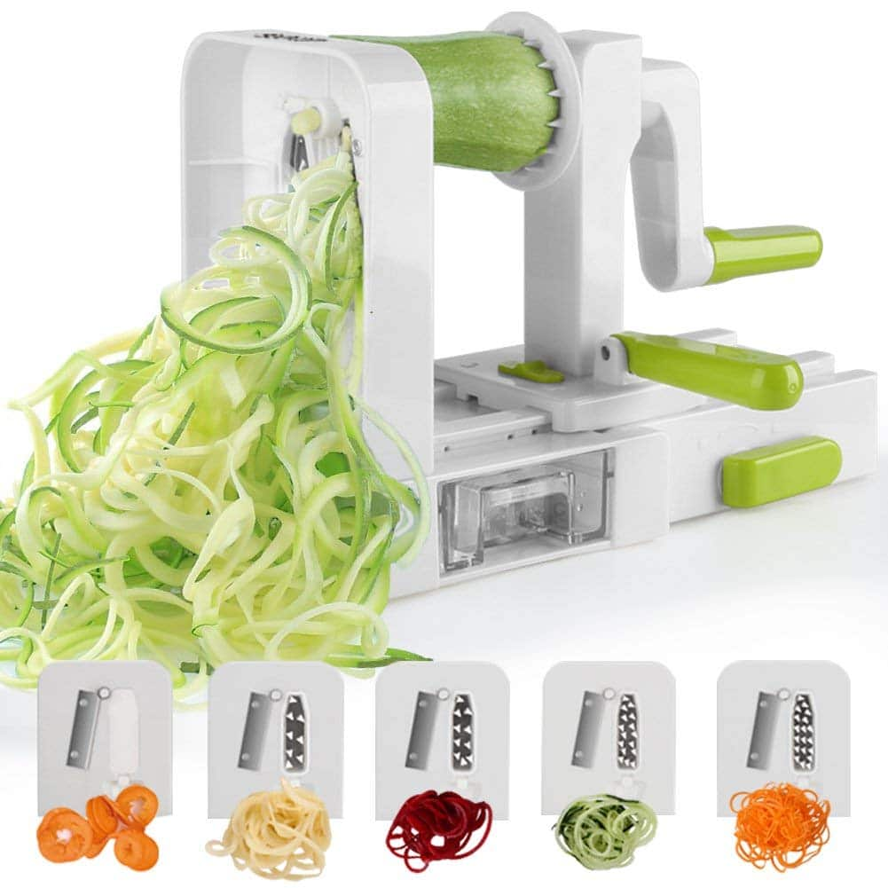 A spiralizer showing spirals of cucumber being processed