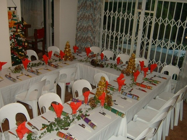 A Christmas table set for 30 people.