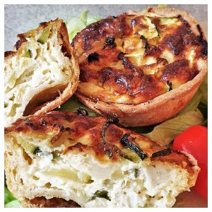 Zucchini and goat cheese tarts on a plate.