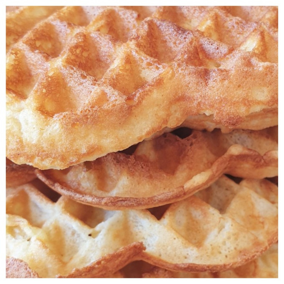 Close up of a pile of waffles showing the texture.