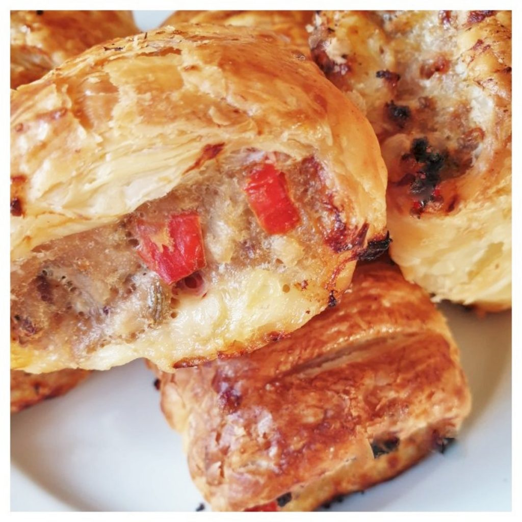 A closeup of the baked pork and apple sausage rolls.