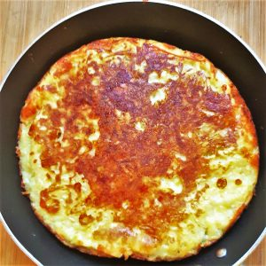 A potato frittata in a frying pan.