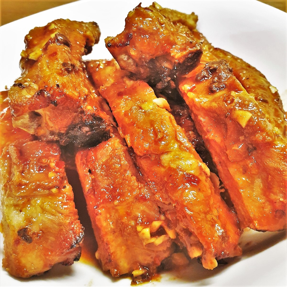A plate of sticky spare ribs.