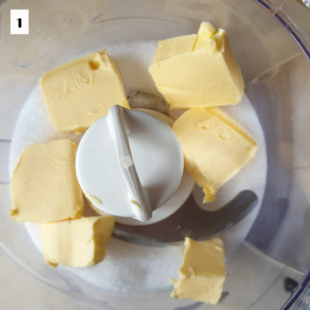 Sugar and butter in a food processor.