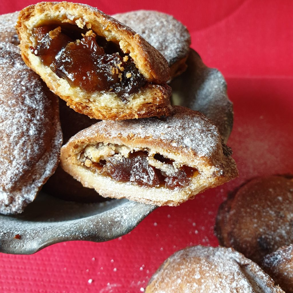 A bowl of Christmas mince pies showing inside.