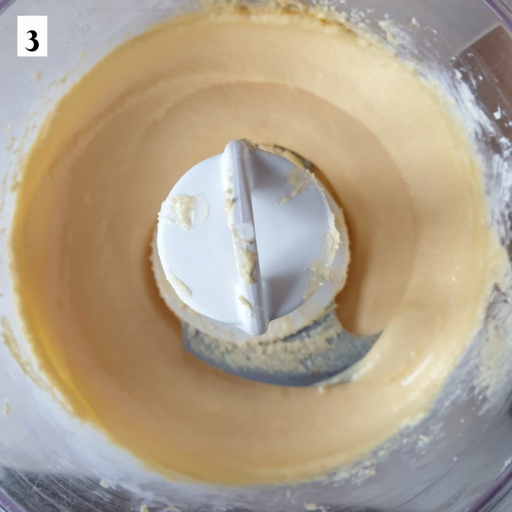 Eggs, sugar and butter whisked together in a food processor.
