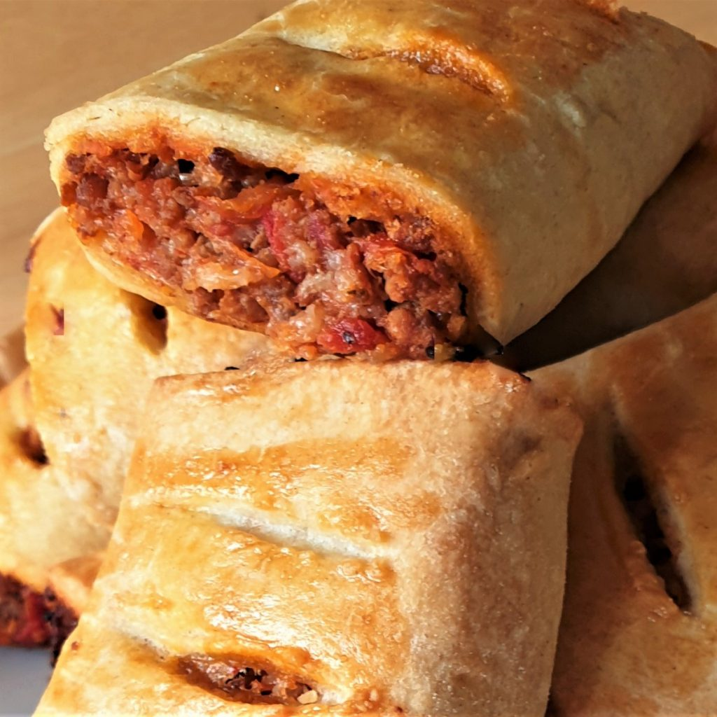 A pile of bolognese sausage rolls.