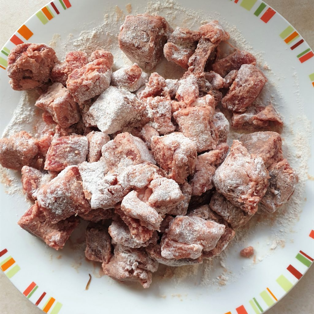 Chunks of beef coated in flour.