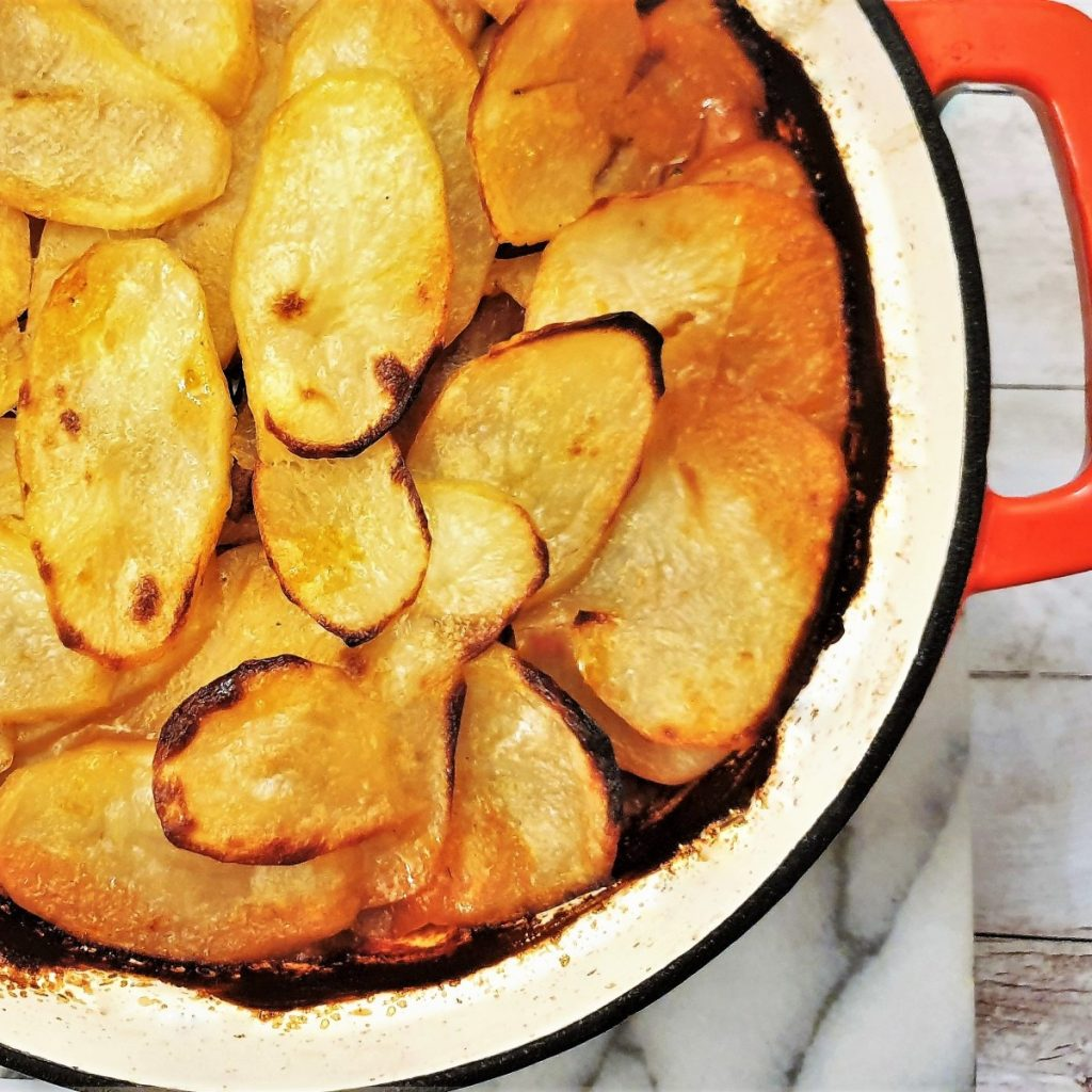 Overhead image of lancashire hotpot covered with potatoes.