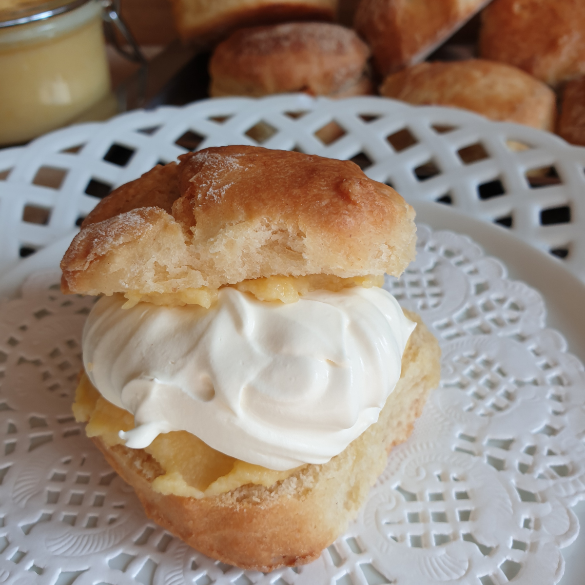 A lemonade scone filled with orange curd and whipped cream.