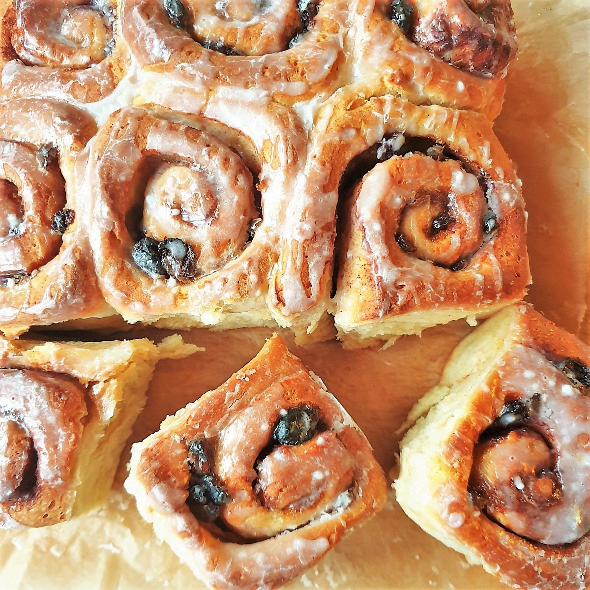 An overhead shot of a tray of chelsea buns.