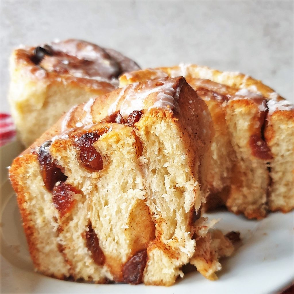 A chelsea bun cut in half to show the inside.
