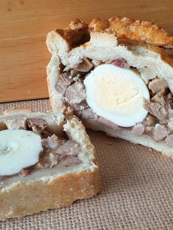 A slice of pork pie with egg