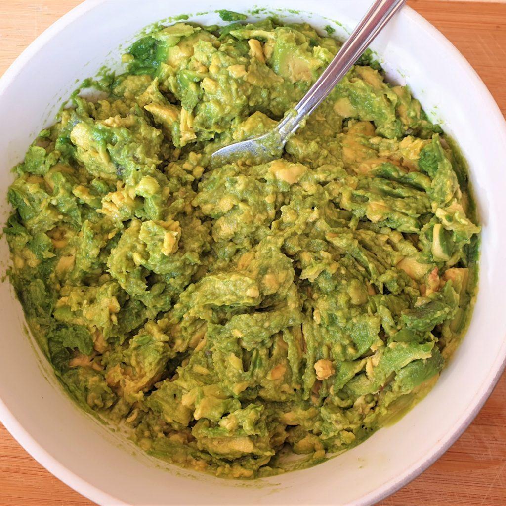 A dish of mashed avocado.