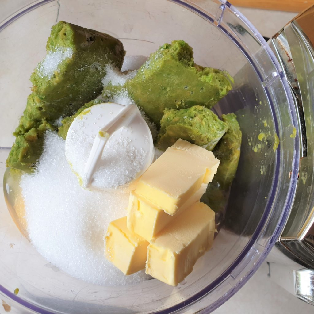 Avocado, eggs, sugar and butter in a food processor.