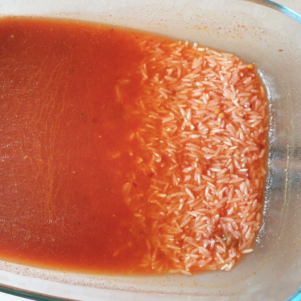 Rice in a dish of sauce.