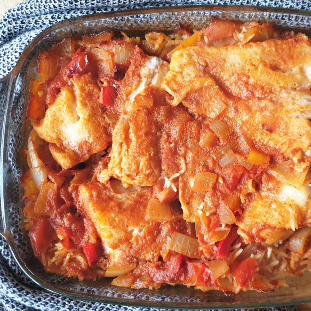 A baked dish of spicy fish and rice.