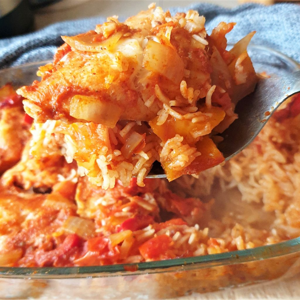 A spoonful of baked fish and rice.