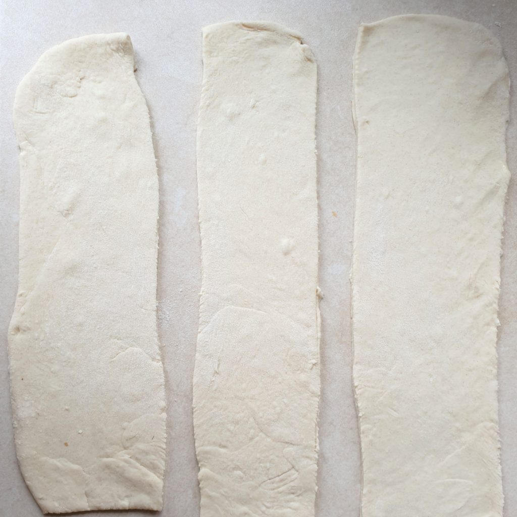 Three strips of rolled koeksister dough.