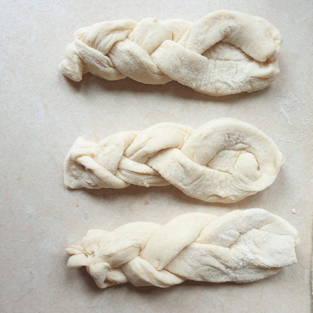 Three koeksisters plaited and ready to be fried.