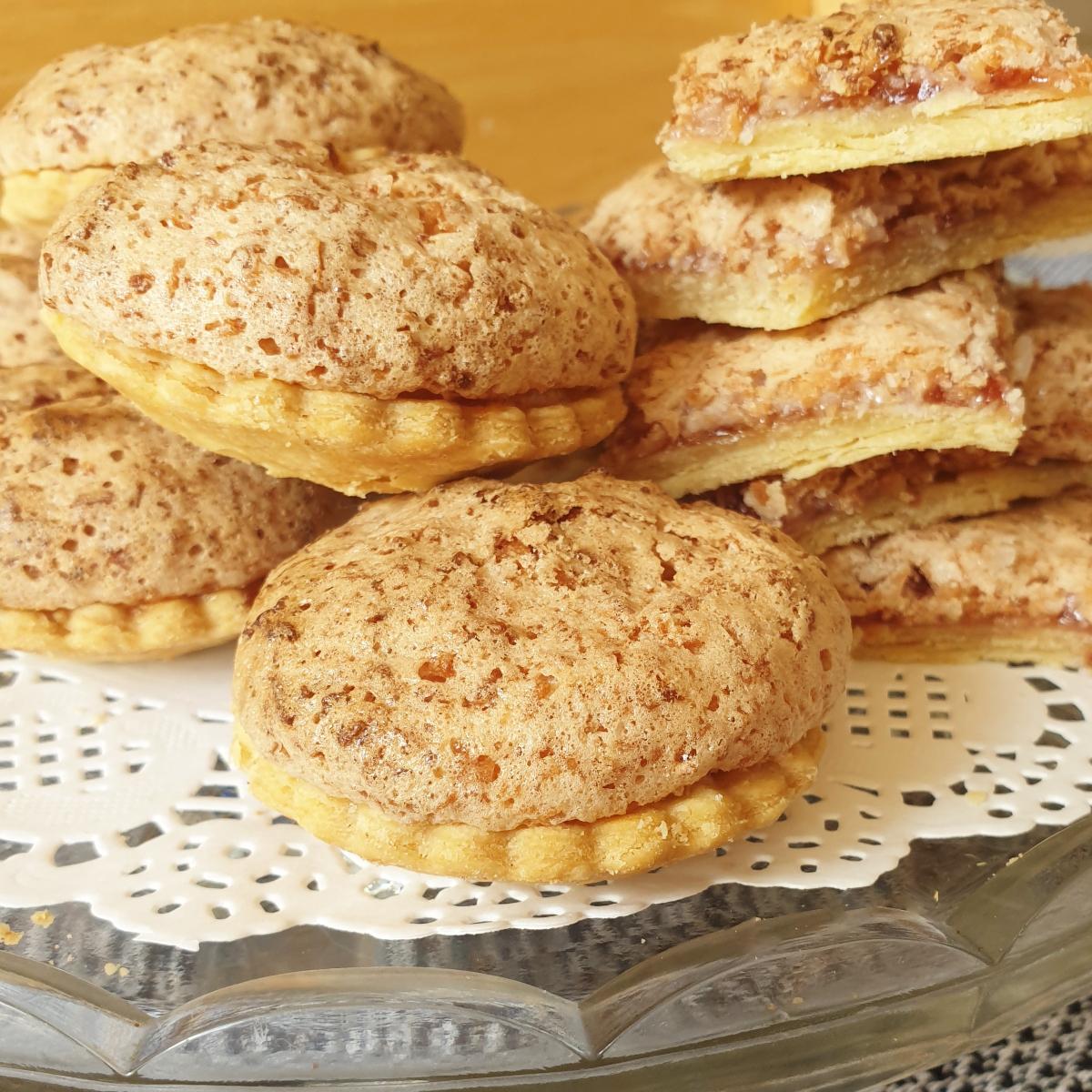 A pile of coconut meringe jam tarts.