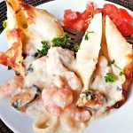 A plate of seafood stuffed pasta shells.