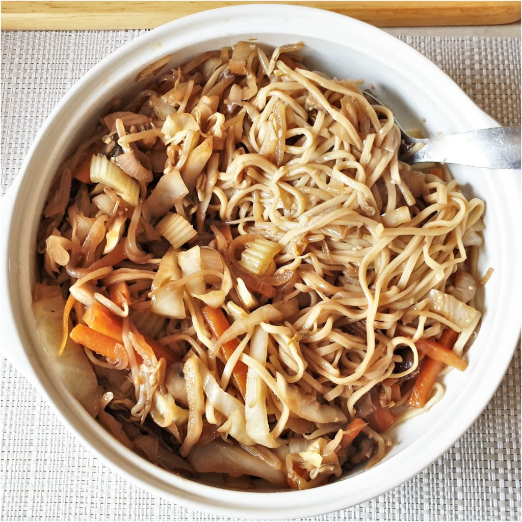 Overhead shot of a bowl of chow mein noodles.