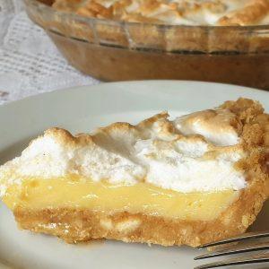 A slice of lemon meringue pie on a plate.