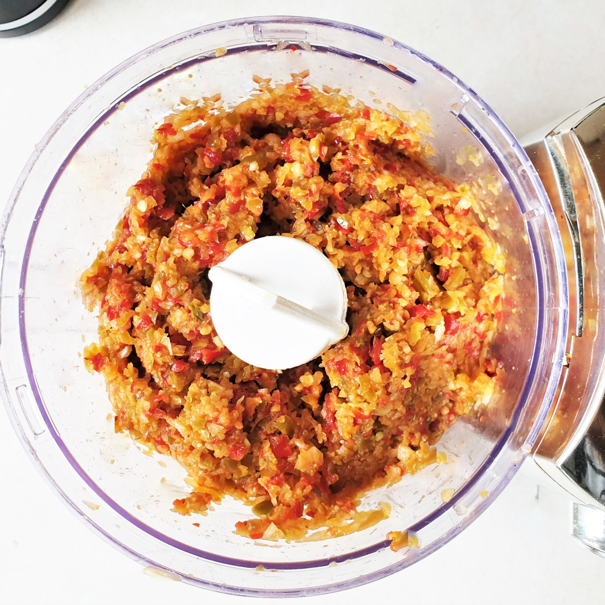 Chili, onion and garlic in a food processor.