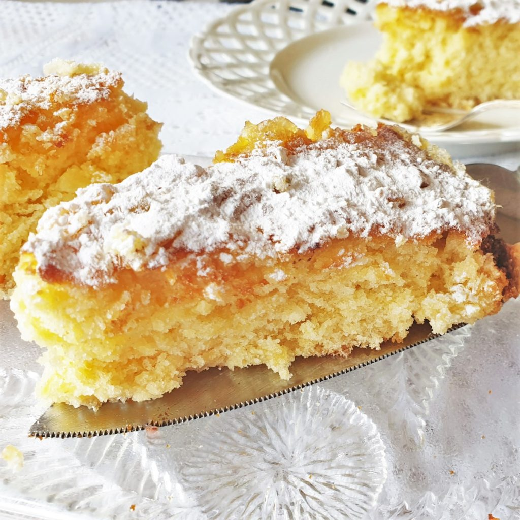 A close up of a slice of pineapple coconut cake showing the texture.