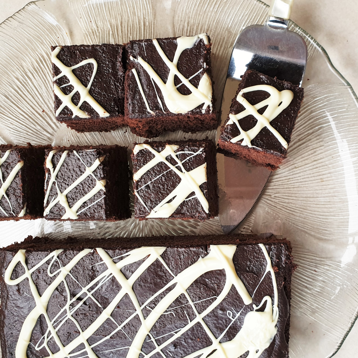 Overhead shot of squares of chocolate cake.
