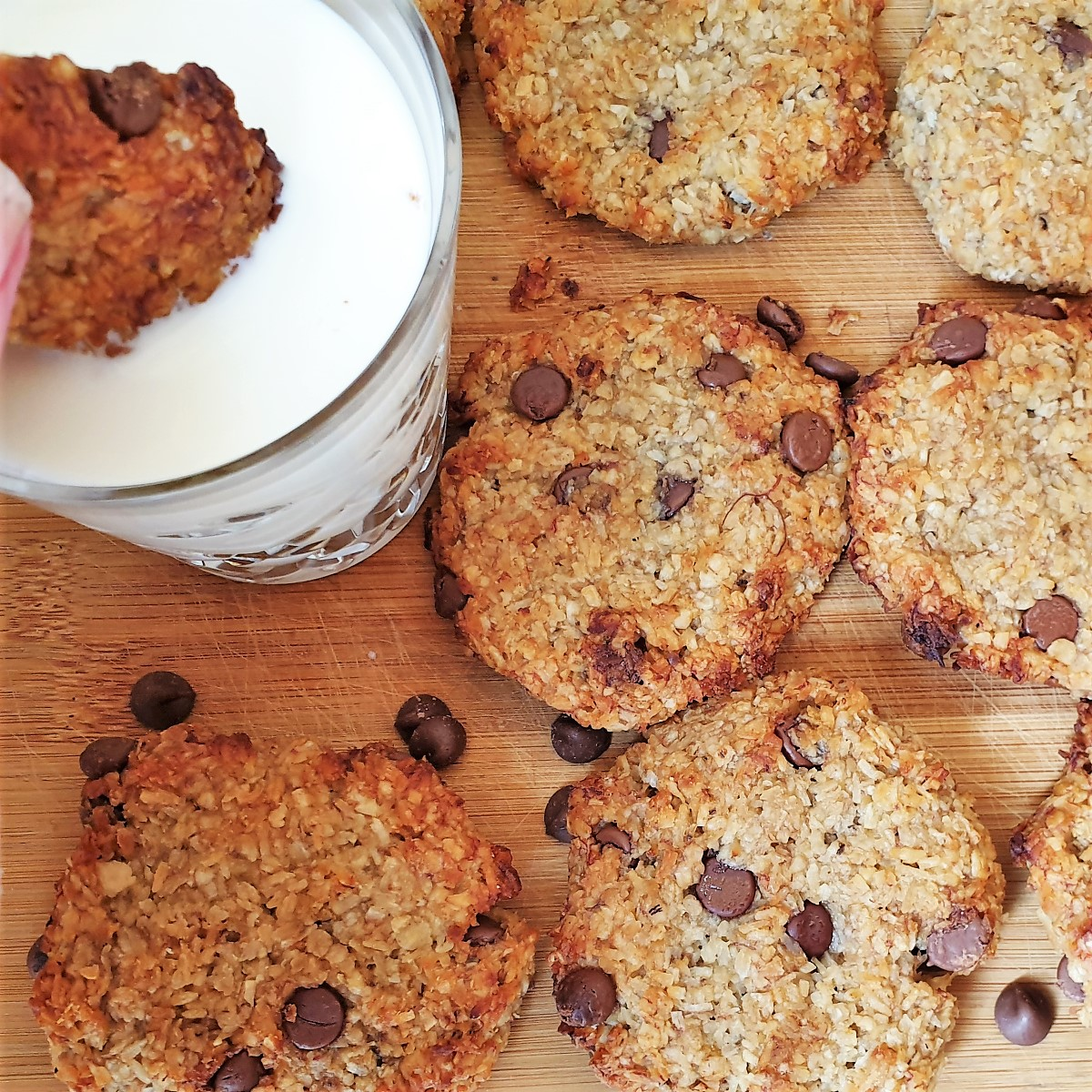 Overhead shot of banana oat cakes with a glass of milk.