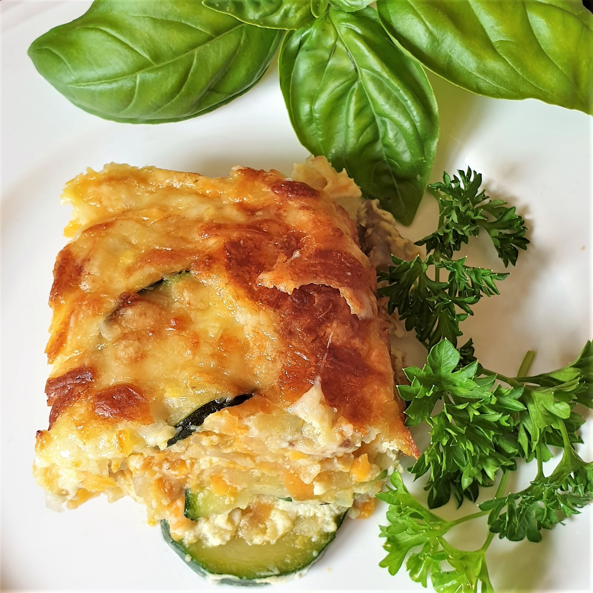 A slice of crustless vegetable quiche on a plate.