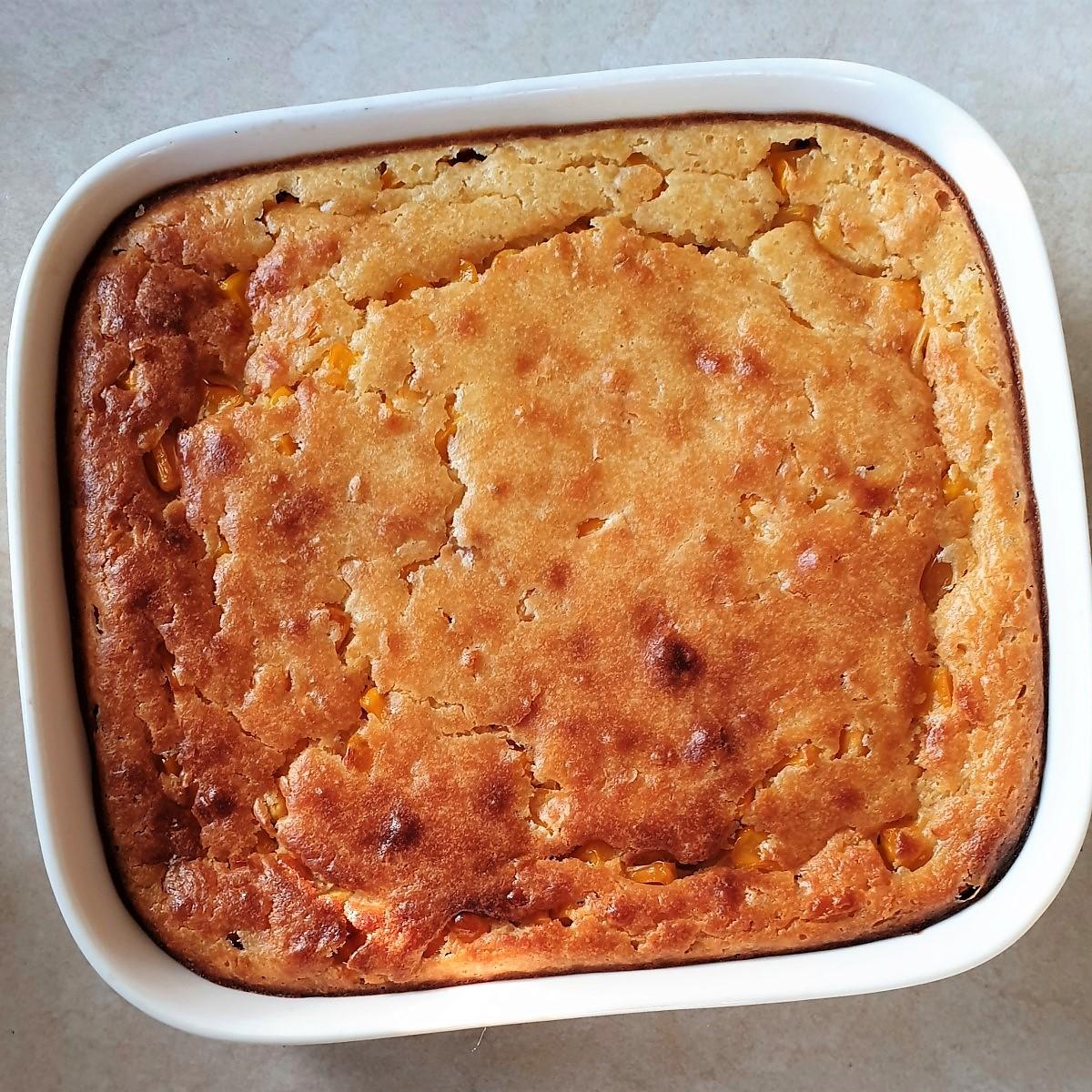 A dish of baked cornbread casserole.