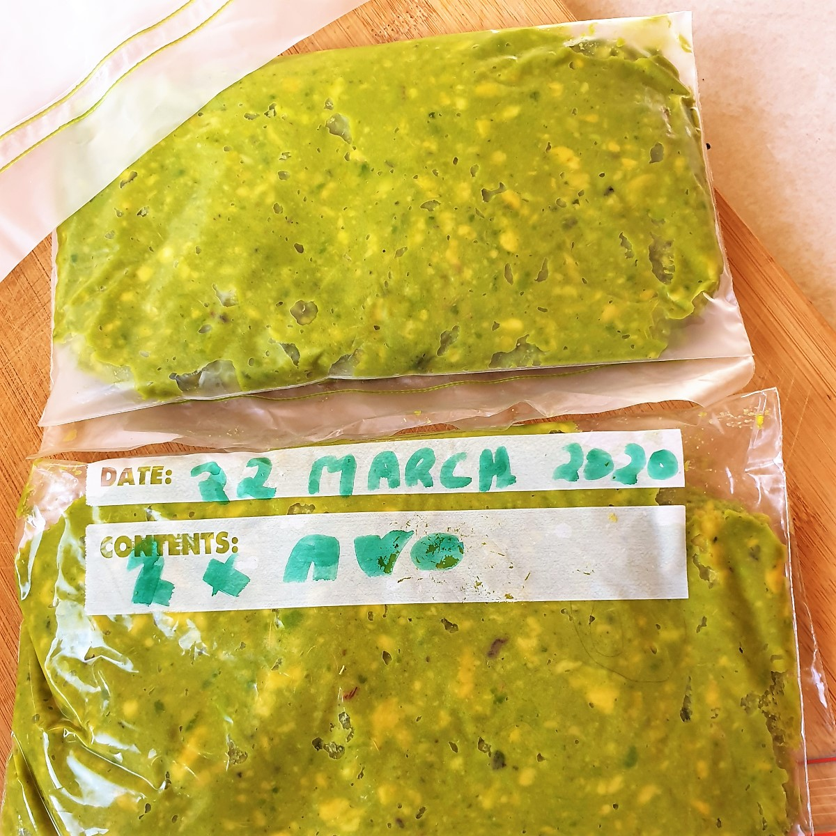 Mashed avocado packed into a freezer bag.
