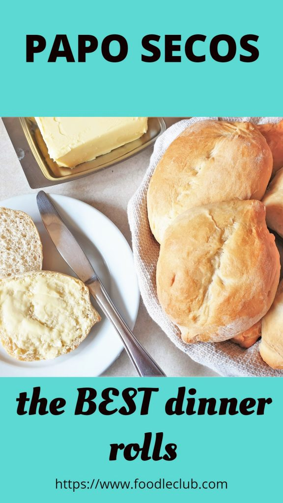 Two Portuguese rolls in a dish alongside a buttered roll.