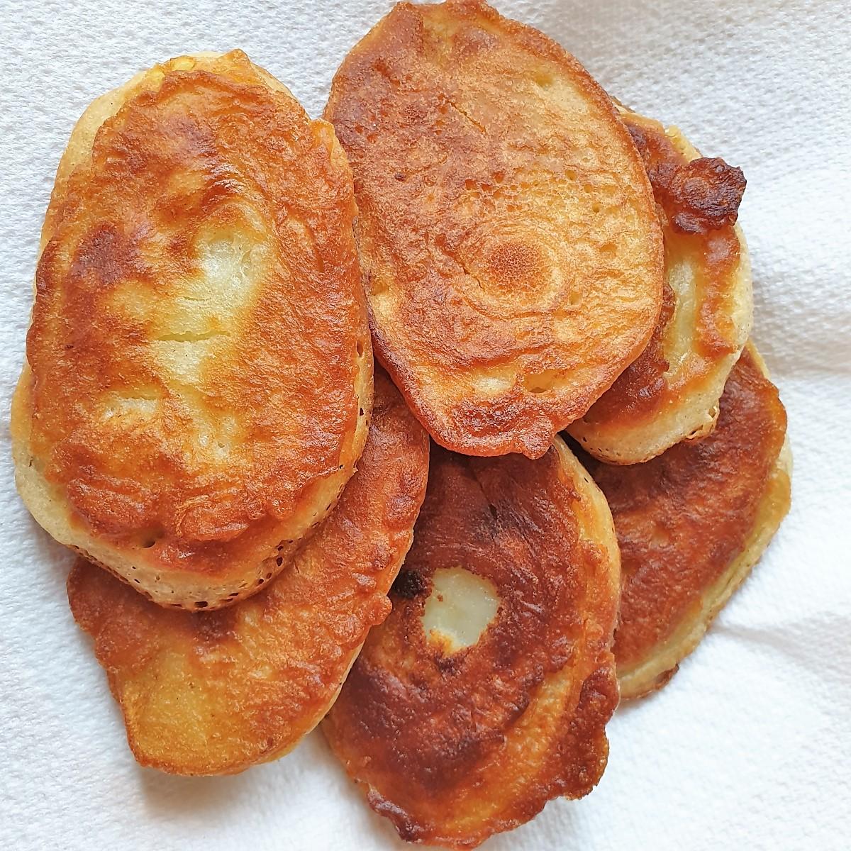 A dish of fried scalloped potatoes.