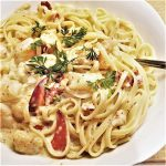 A bowl of creamy seafood linguine.