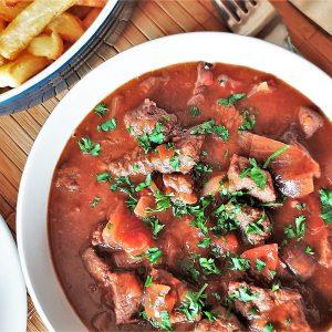 A closeup of a bowl of beef trinchado.
