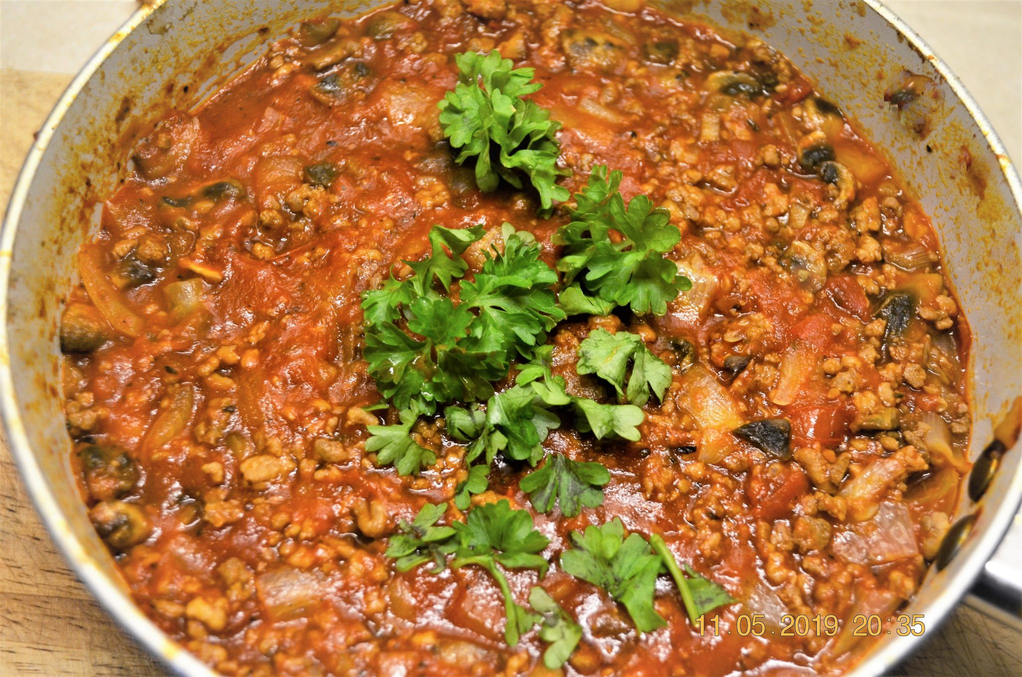 A pan of chilli bolognese sauce.