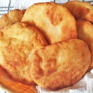 A pile of 2-ingredient vetkoek in a basket.
