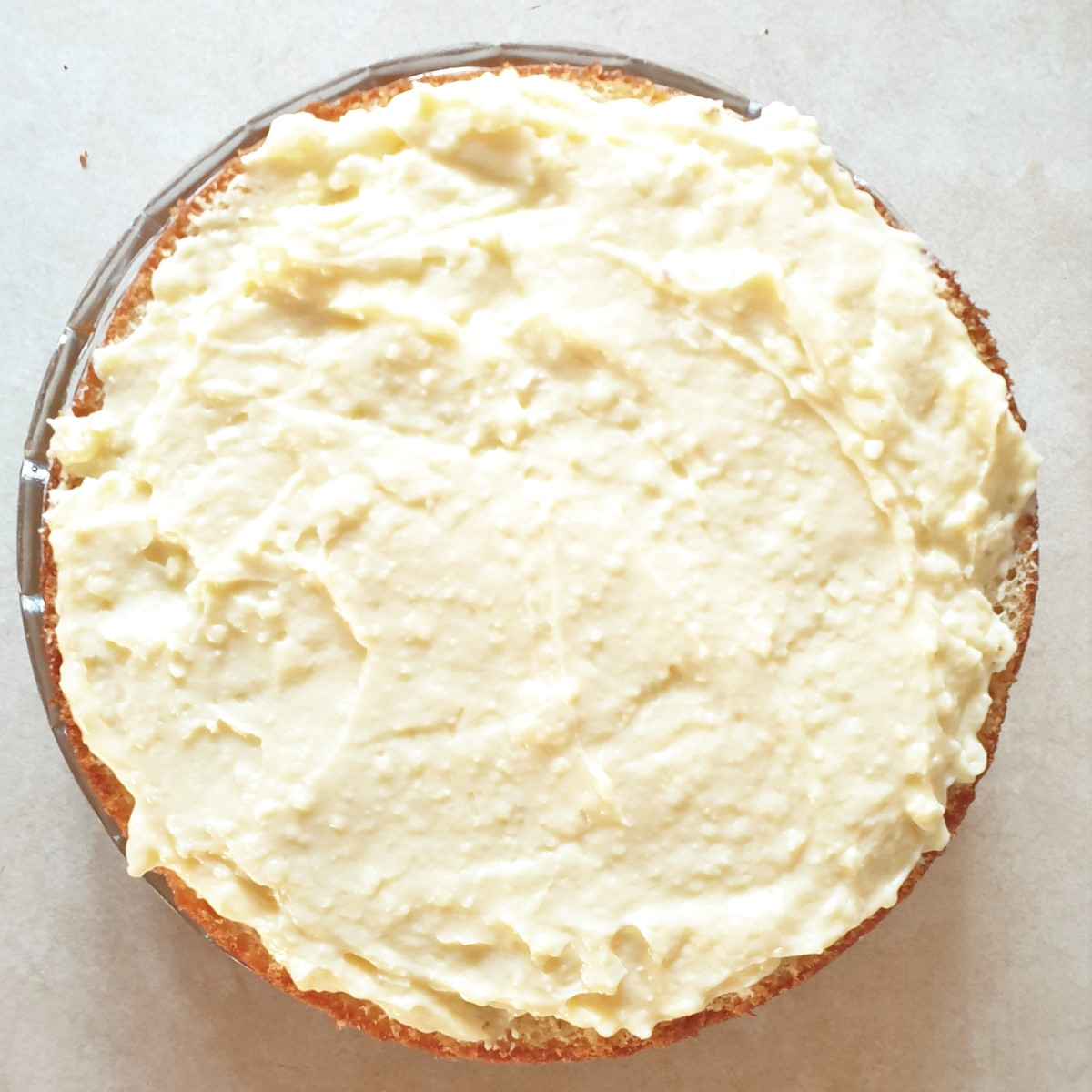 A cake cut in half and spread with creme patissiere