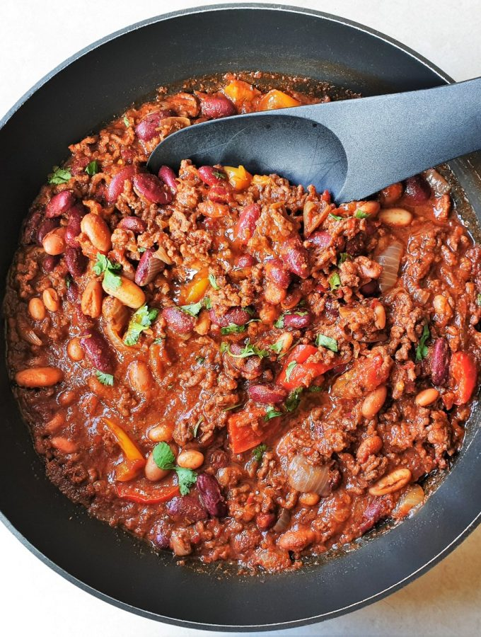 Chilli con carne in a pan with a spoon