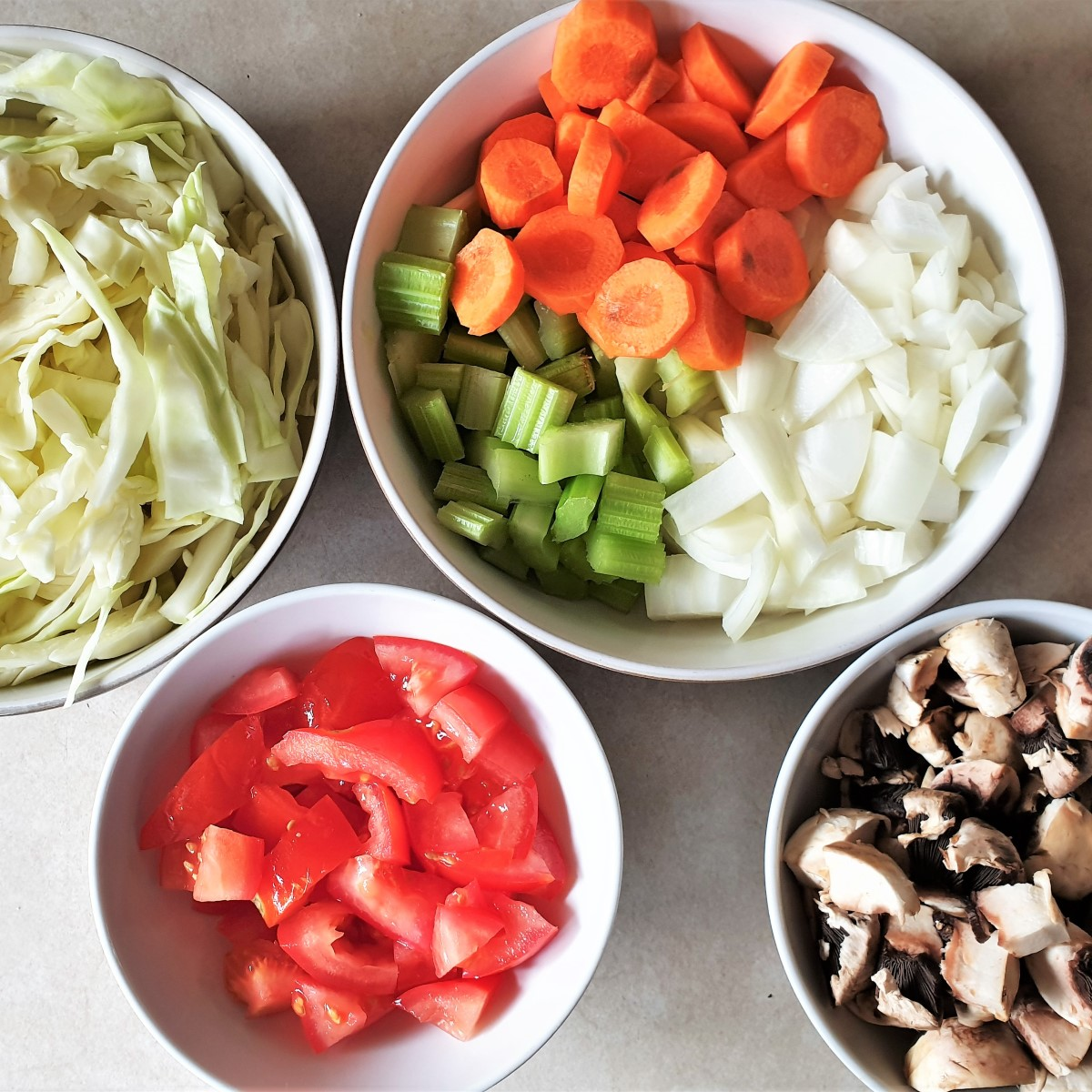 Bowls of chopped vegetables for the meatball soup.